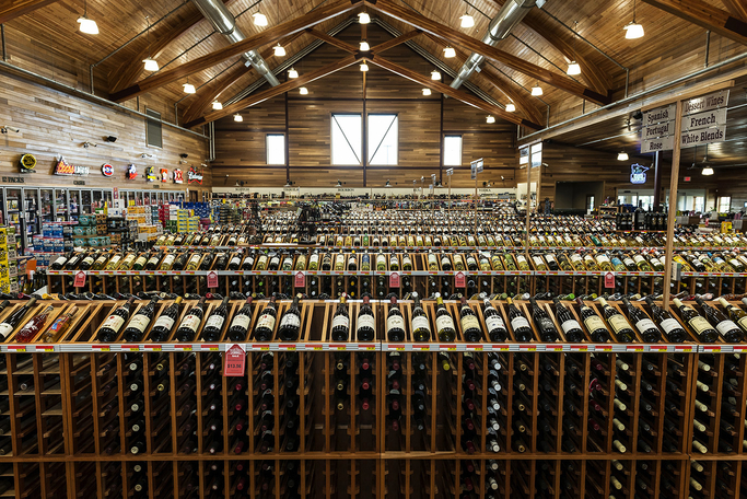 In 2017, Happy Harry's Bottle Shops (wine shelves pictured) contributed nearly $150,000 to 96 different charitable organizations, both near and far from the company's base.
