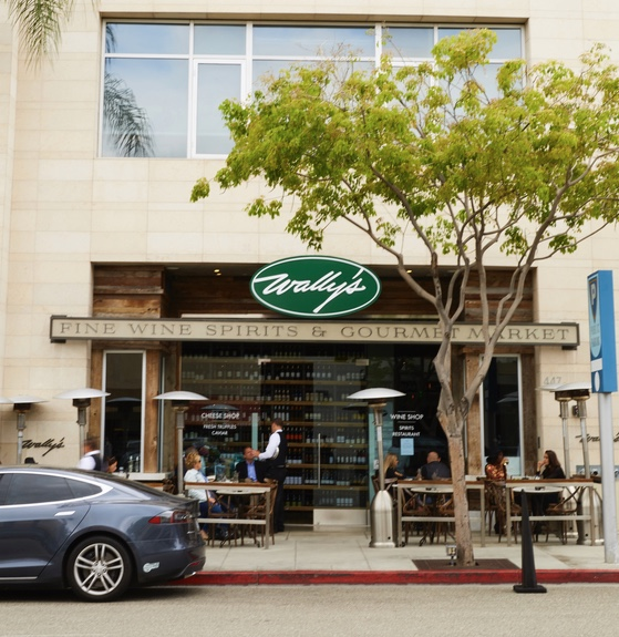 Wally's is moving away from a traditional wine store model toward a modernized hybrid restaurant-retail business. The first iteration of this concept is based in Beverly Hills (exterior pictured) and showcases high-end luxury products, with seating for 160 people.
