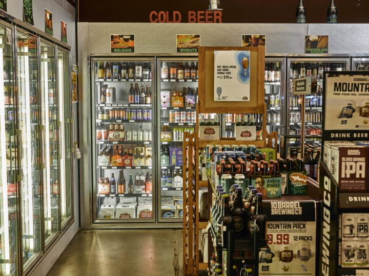 Downtown Spirits (beer coolers pictured) focuses its beer selection on local craft products, with top-sellers including Black Raven Updraft pale ale and Deschutes Fresh Squeezed IPA.
