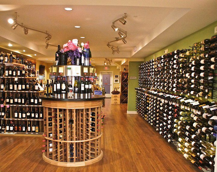 Retailers such as Cape Cod Package Store (pictured) in Centerville, Massachusetts are fighting against a proposed ballot initiative that would allow retailers to possess unlimited beer and wine licenses in the state. Currently, law states retailers can hold nine licenses in 2020.