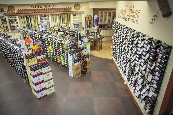 A member of the board of directors of the Massachusetts Package Store Association, Ryan Maloney of Julio's Liquors (interior pictured) in Westborough, says that eliminating the cap of beer and wine licenses would give retailers like Cumberland Farms an unfair advantage in the state.
