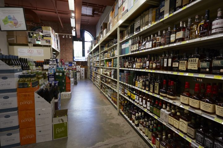 Luis refuses to stock low-end beverage alcohol at Sparrow (shelves pictured) so he can ensure an upscale clientele.