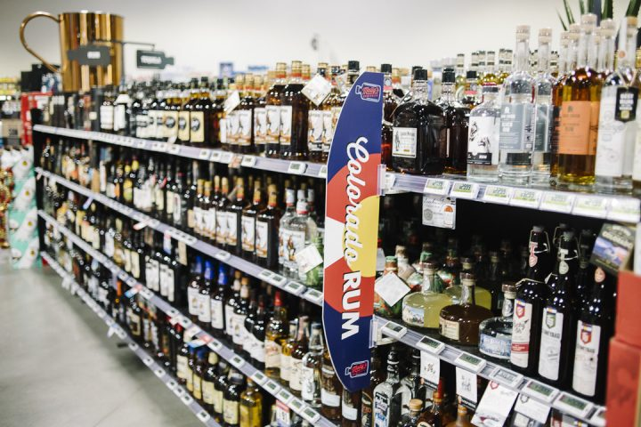 Spirits (shelves pictured) make up roughly a third of sales at Molly's, with local Colorado spirits particularly popular among customers.
