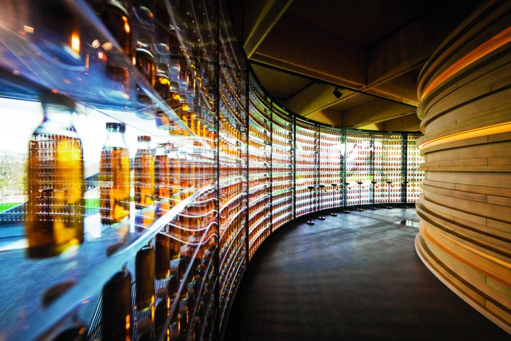 Distillery expansions have accompanied the rampant innovation ongoing at many single malt Scotch brands. Macallan's new distillery includes a wall of 3,000 bottles (pictured) that illustrate the range of natural colors the brand's whisky takes on through cask maturation.