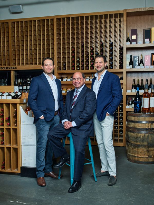 As president of Gordon's Fine Wines & Liquors, Rick Gordon (middle) oversees five storefronts throughout the Greater Boston Area alongside his sons, vice presidents Kenny (left) and David (right).