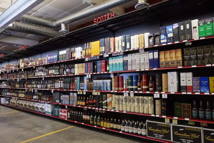 Downtown Spirits offers about 2,500 different spirits (shelves pictured) and has partnered with brands like Woodford Reserve, Eagle Rare, and Buffalo Trace on exclusive single-barrel offerings.