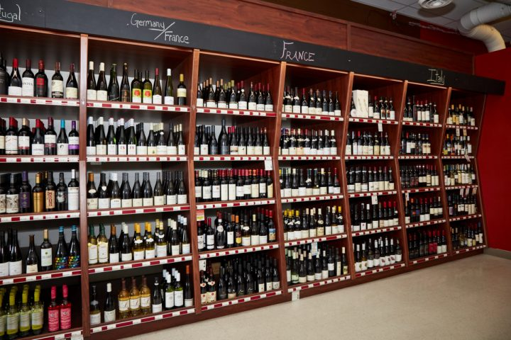 Downtown Spirits (wine shelves pictured) offers approximately 1,000 wine SKUs, with Washington Cabernet Sauvignons among the top sellers.