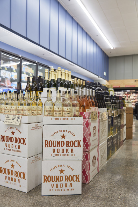 Craft labels across all spirits categories (Round Rock vodka display pictured) are becoming more popular at Vons, Albertsons, and Pavilions stores.