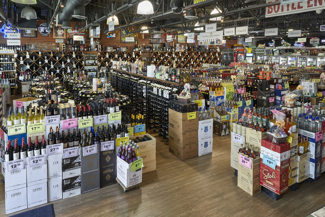 Cruz purchased his first liquor store in 1988 with help from his father, Eduardo Cruz, Sr., expanding the Jensen's banner. Cruz ultimately acquired the flagship SW 27th Avenue store (interior pictured) from his father, and has since added four more locations.