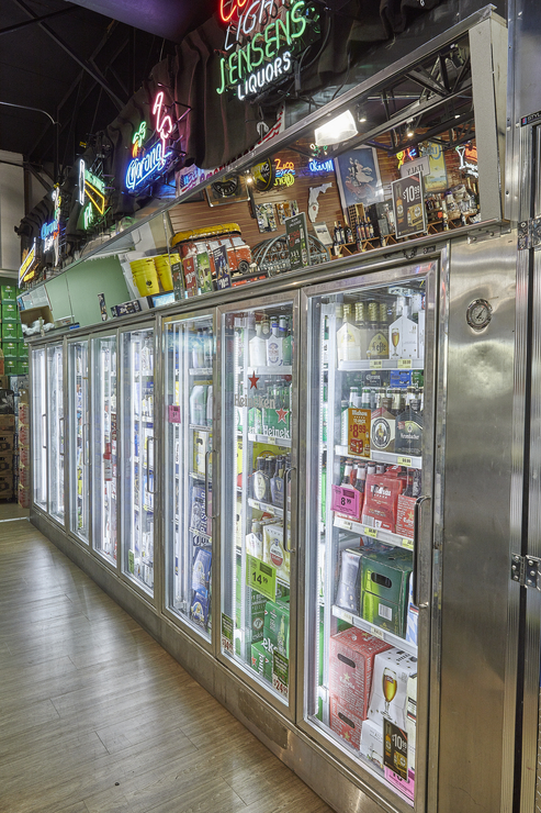 Jensen's stocks about 6,500 beer SKUs (coolers pictured), which comprise 10% of total sales. While many major domestic brands are struggling, Cruz says that local craft offerings are still going strong.