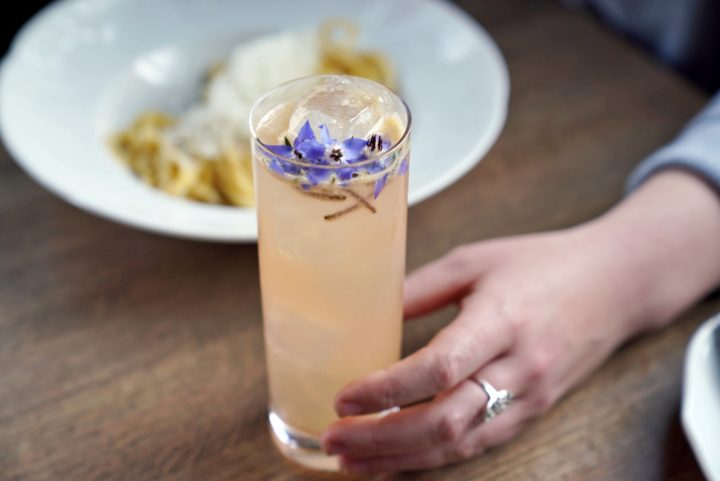 The Catalina Wine Mixer (pictured) at Etta in Chicago has a base of Hendrick's Orbium gin and Dassai Nigori Junmai Daiginjo sake, mixed with house-made cantaloupe-ginger syrup, lemon juice, Gratien & Meyer Crémant de Loire Brut Rosé, and mint.