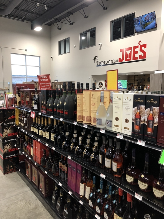 At Joe's Beverage Warehouse (shelves pictured) in Illinois, Cognac's popularity is growing, with brands like D'Ussé gaining ground on category stalwart Hennessy.