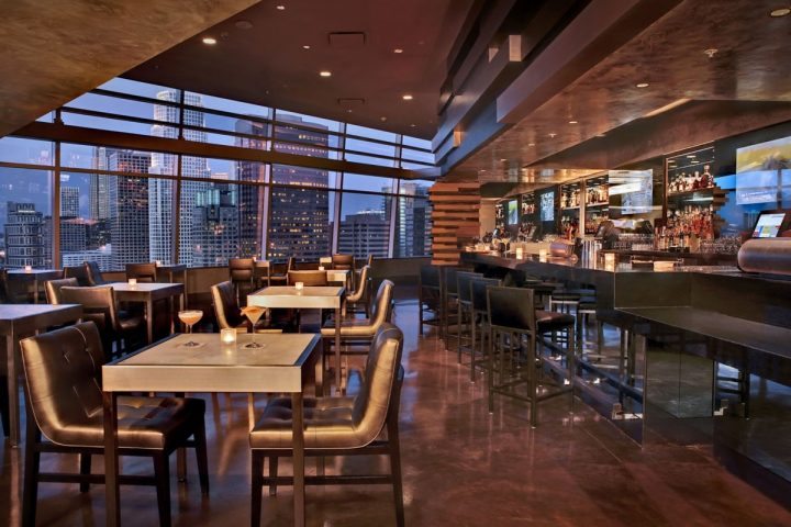 At the Ritz Carlton's WP24 by Wolfgang Puck venue (interior pictured), beverage operations manager Courtney Hamblin mixes Green Chartreuse alongside Monkey 47 gin in the Green Envy Martini.