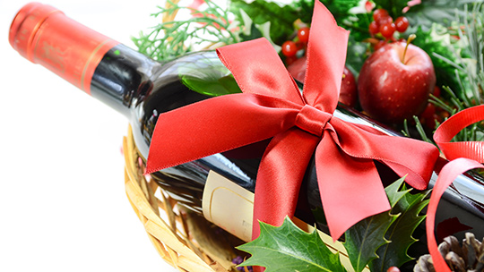 To entice customers before the new year, Escondido, California's Holiday Wine Cellar offers discounts for purchases of six and 12 bottles of wine and spirits.