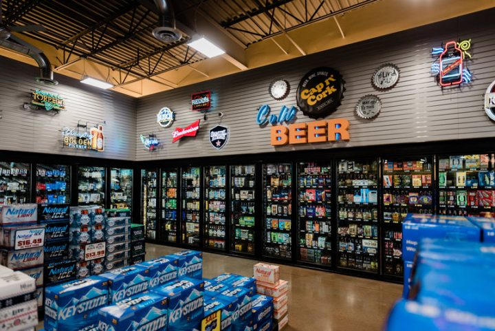 Cap n' Cork stocks 4,700 beer SKUs, and the category makes up 40% of its sales. The store's beer department (beer coolers pictured) comprises craft brands and mainstream names.