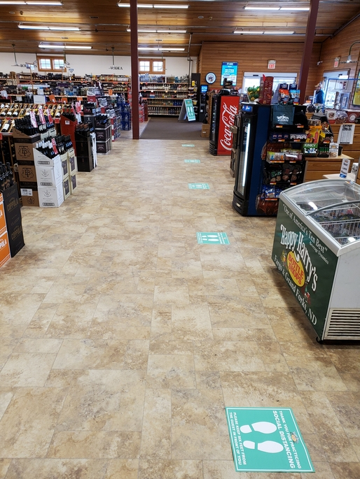 Social distancing measures are also being strictly enforced at Happy Harry's locations, with markings added to the floor noting where people can stand on line.