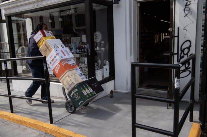 As crowds rushed to the off-premise, stores adapted by offering more delivery and curbside pickup (Washington D.C. spirits delivery pictured).