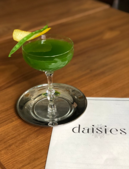 The Green Giant (pictured) from Daisies blends Cimarron Blanco Tequila, John D. Taylor's Velvet Falernum liqueur, juiced green beans, simple syrup, lemon and lime juices, and Regans' No. 6 Orange bitters.