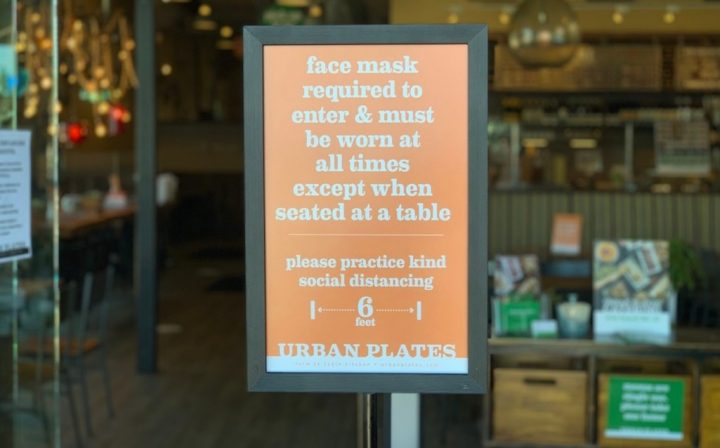 California-based Urban Plates (sign pictured) has implemented measures including including requiring facemasks and keeping tables at least six feet apart to ensure customer safety.