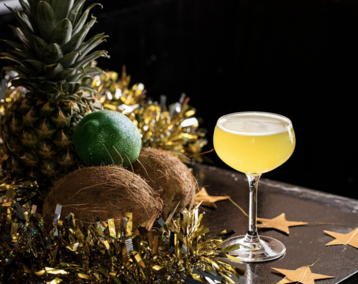 Nitecap's the Sun Lite, Moon Lite cocktail (pictured) mixes herbal wine with rum, liqueur, lime juice, and syrup, and is topped with a sparkling rosé wine.