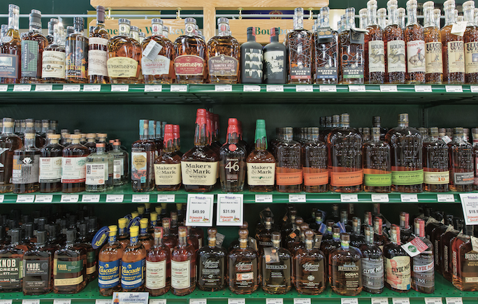 As the Covid-19 pandemic gripped the nation, beverage alcohol retail bucked the negative economic trends, surging at robust double-digit rates. Whiskies (Bourbon shelves at Haskell's in Minneapolis pictured) showed strong growth from an already-large base.