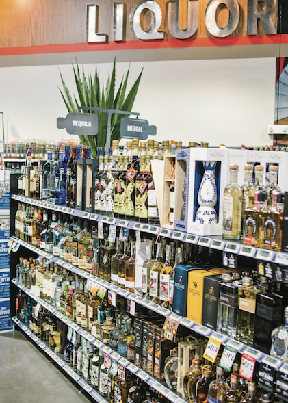 Tequila (shelves at Molly's Spirits in Denver pictured) has also been popular among consumers during the Covid-19 crisis, growing 60% in the four weeks ending May 16, 2020 as compared to 2019.