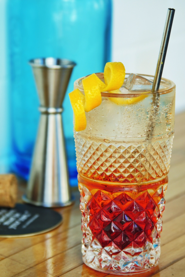 The Venetian Soda combines two liqueurs and an aperitif with bitters and seltzer.