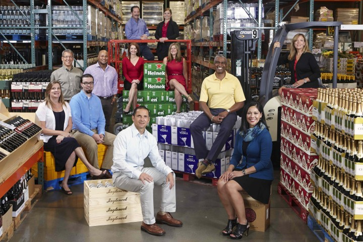 Costco's beverage alcohol merchandising, overseen by Annette Alvarez-Peters (seated front right with her team of buyers), uses a