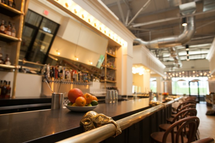 The Luminary's 3,500-square-foot design is simple and sophisticated, with tiled walls, wood furniture, gleaming lights and a bar that's situated under 100-year-old trusses.