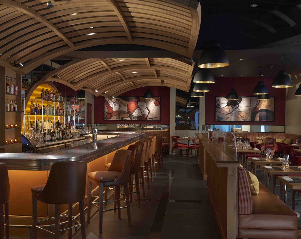 Bar Boulud Boston, chef Daniel Boulud's first venture in the city, features a glass-enclosed wine cellar, a marble-clad charcuterie counter, and oak and leather furnishings.