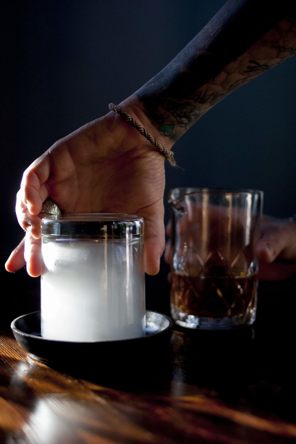 The Lawless cocktail blends Bourbon, malört, tobacco-infused bitters and sugar, served in a glass smoked with vanilla custard tobacco.