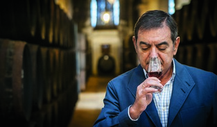 Lustau winemaker Manuel Lozano samples Sherry from the solera. Lustau's range includes both large brands and boutique, small-production wines.