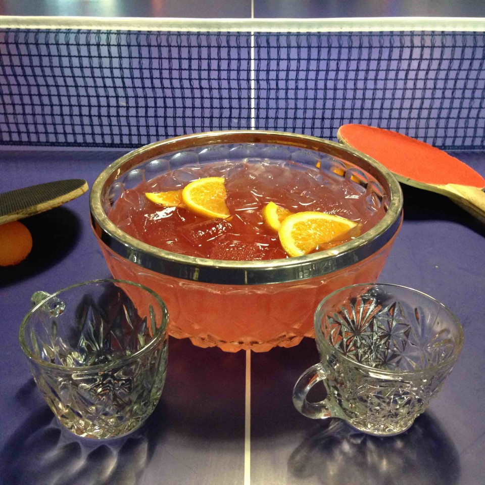 Punch Bowl Social's You Must Bring Us...A Shrubbery! features Skyy Infusions Moscato Grape vodka, house-made watermelon shrub, house-made cardamom syrup, lemon juice, orange slices and a float of Ensemble Red Blend wine.