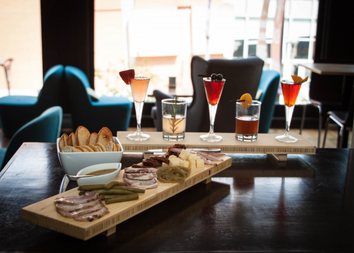 Columbus' on-premise offerings rival those of larger cities. Denmark on High pairs cocktail flights with charcuterie (pictured).