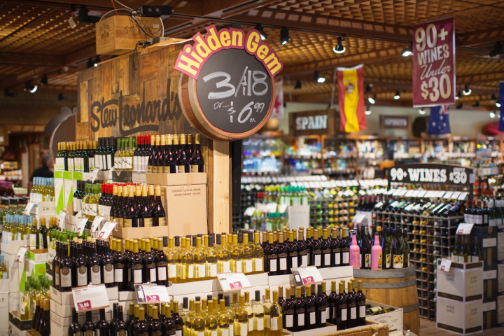 "Wine, which generates two-thirds of sales, is organized by region with clear, bold signage and includes displays like the ""Hidden Gem"" section, highlighting new and lesser-known wines."