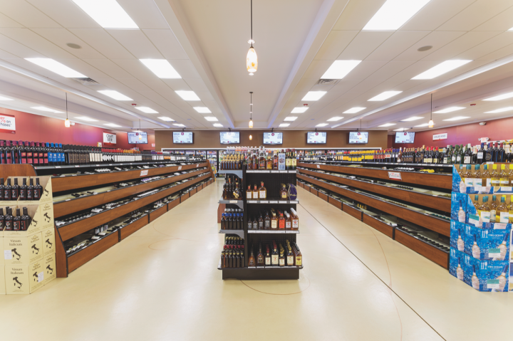 Wine Chateau stores feature wide aisles, bright lighting and LCD screens, resulting in a modern, welcoming interior.
