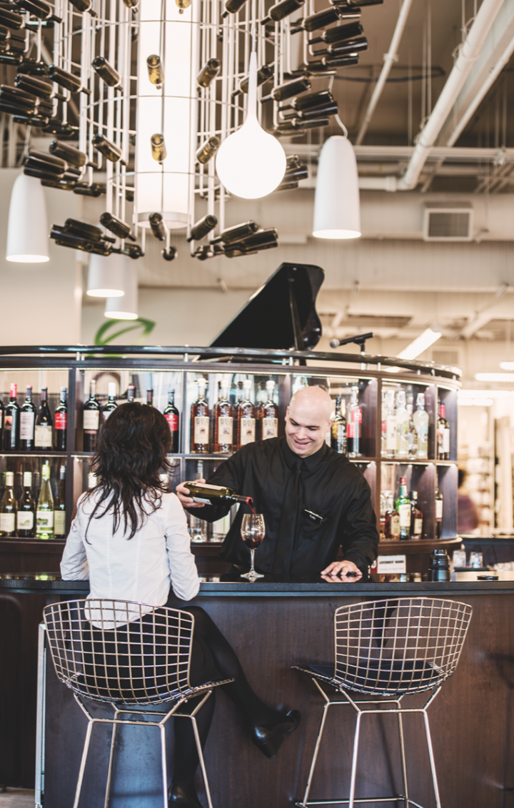 In-store amenities such as tasting bars help demonstrate the value of a wide array of wines to customers.
