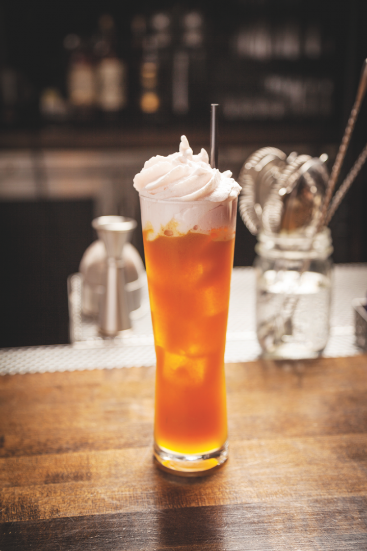 At Chicago bar Bottlefork, liqueurs are employed with a host of ingredients. The Look Out Below features aged rum, overproof rum, spiced herbal orange liqueur, pineapple-coriander shrub, lime and passion fruit juices, and a coconut–Angostura bitters foam.