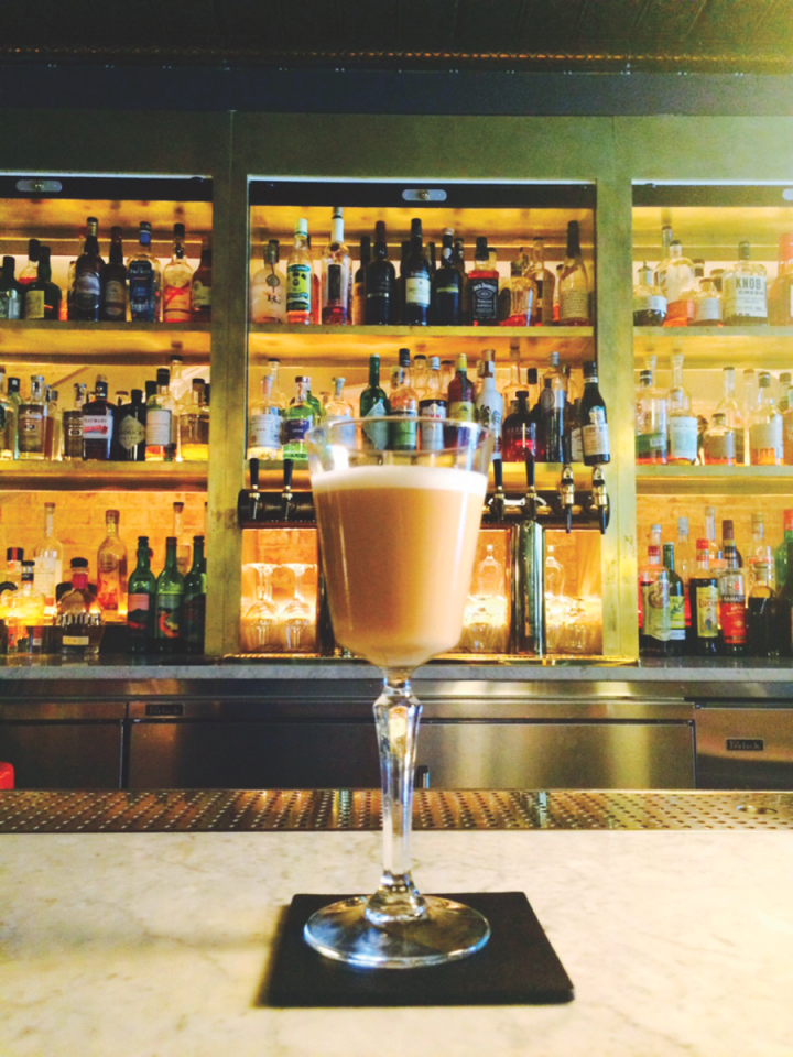 Fat-washed spirits add complexity and texture to cocktails. In Seattle, Pennyroyal Bar's Follow the Map drink (pictured) features duck fat–washed rum, ricotta cheese, lemon, ginger and honey.