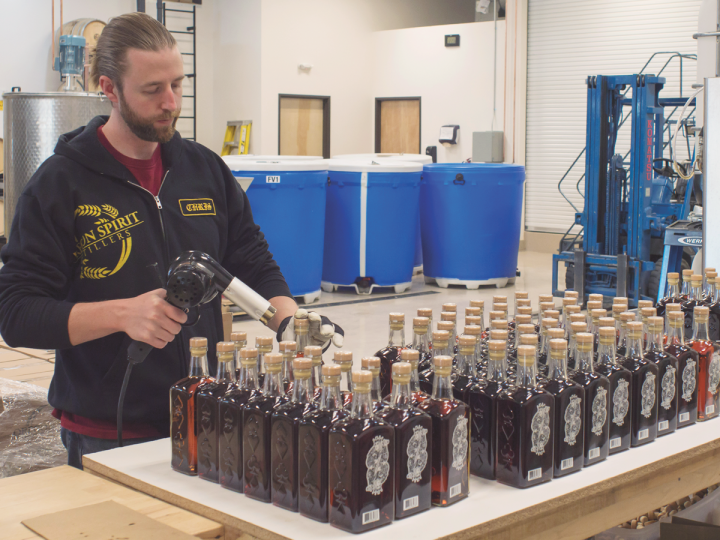 Most craft distilleries serve a particular region. Oregon Spirit Distillers (production assistant Chris Deck pictured) primarily offers its absinthe- and rum-driven lineup in the Pacific Northwest.
