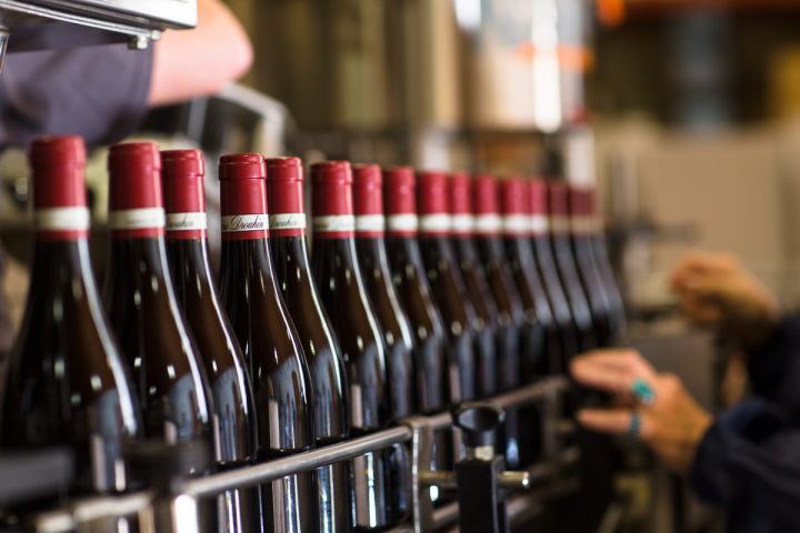 Besides Domaine Drouhin (bottling line pictured), other European and California producers are staking a claim in Oregon.
