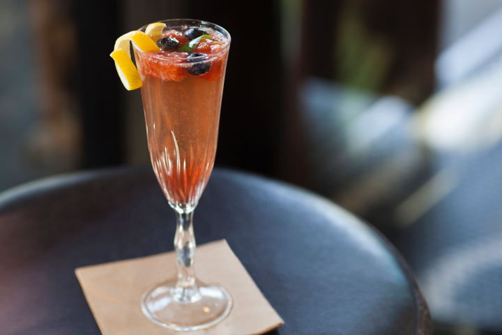 Ox & Son's Champagne Sangria ($11) mixes Prosecco, lemon juice, grenadine, orgeat syrup and oleo saccharum.