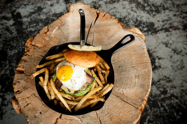 Food makes up 40 percent of Punch Bowl Social's revenue, and offerings include items like Stacked Burger that pair well with the drinks menu.