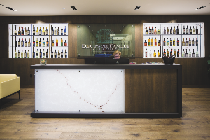 Deutsch Family Wine & Spirits (reception desk pictured) has annual revenues that exceed $600 million and continue to grow.