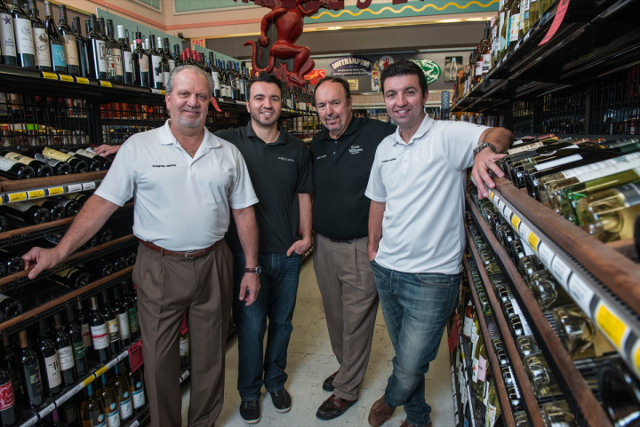 The chain is run by (from left) founder Gary Gianoukos, I.T. director Chris Knightly, founder George Knightly and wine director Bryan Knightly.