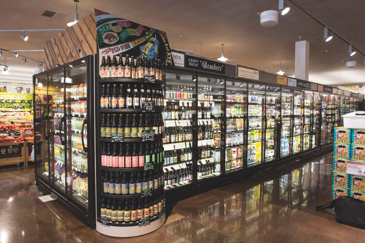 At Raley's grocery stores (beer cooler pictured), craft beer is placed in the middle of the flow to highlight the 135-unit chain's wide selection of offerings, reflecting the rising demand for high-margin beer.