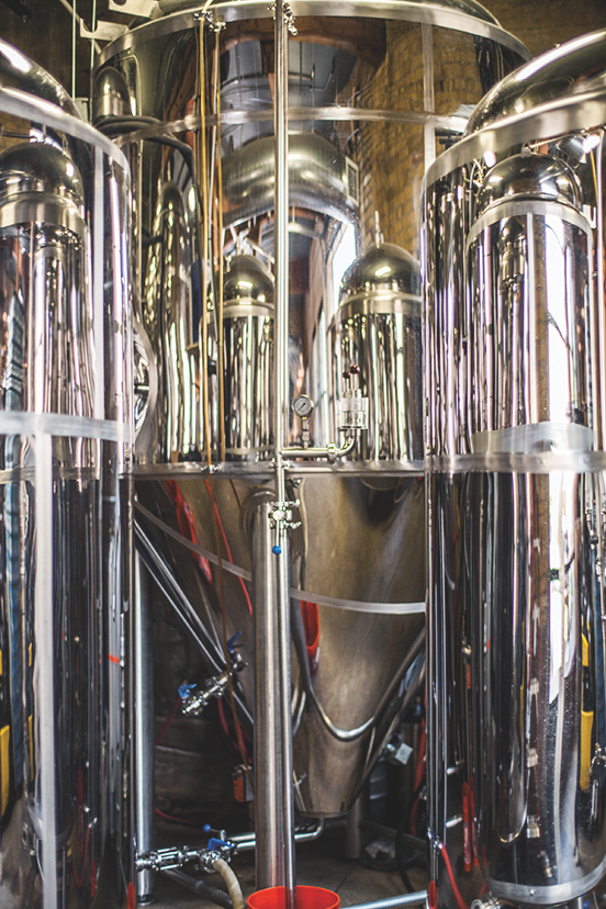 Minnesota's two largest cities share a vibrant beer and spirits culture, exemplified in craft breweries like 612Brew (equipment pictured).