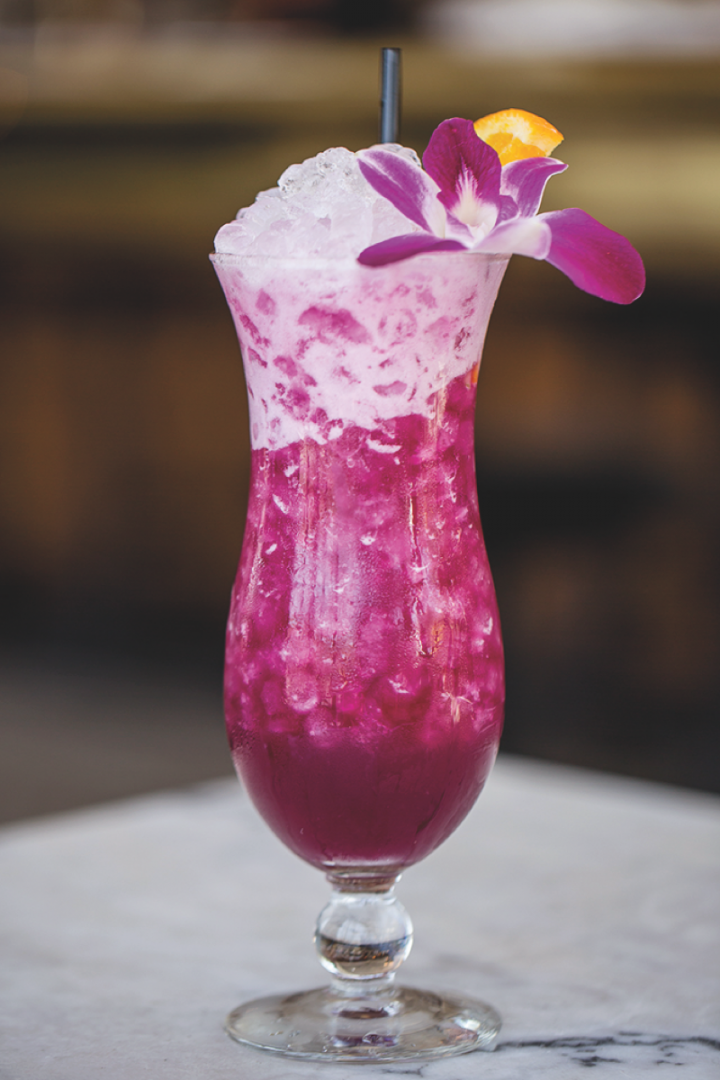 The Purple Haze at Polite Provisions in San Diego blends bright citrus flavors with floral aromas for a colorful summer libation.
