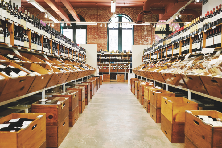 Armando Luis puts great emphasis on creating an appealing store aesthetic, which he achieves with artful touches like custom-made maple boxes for wine display (pictured) and reprints of wine scores encased in plastic and clipped onto the boxes.
