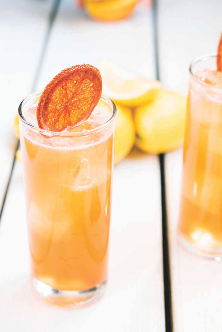Bartaco's Oaxaca Spritz (pictured) blends mezcal, aperitif, and fresh guava and lemon juices.